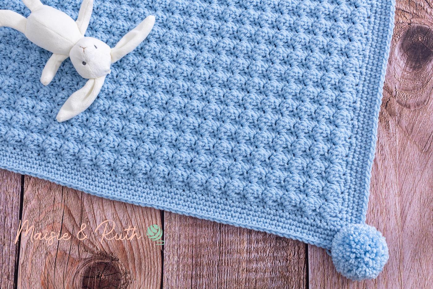 Easy Crochet Baby Blanket Flatlay with White Bunny