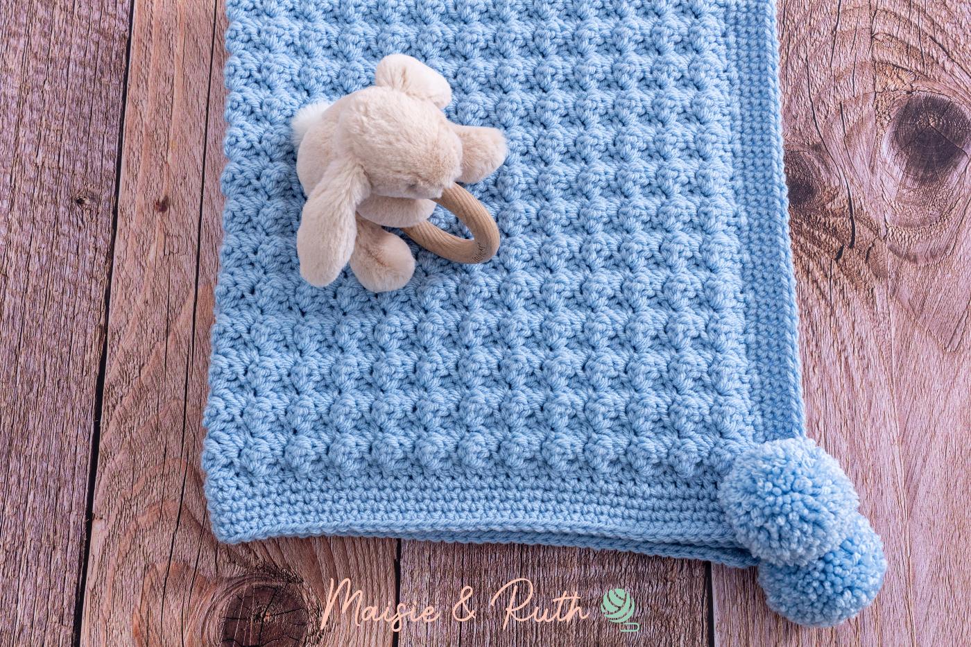 Easy Crochet Baby Blanket on wood table