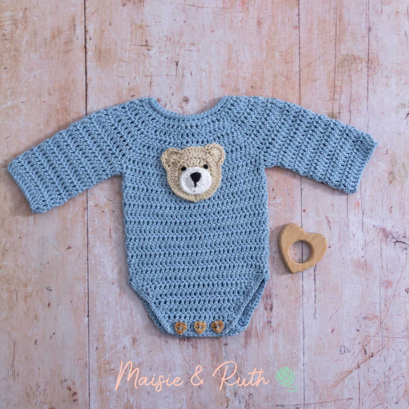 Crochet Baby Onesie Pattern with wooden heart