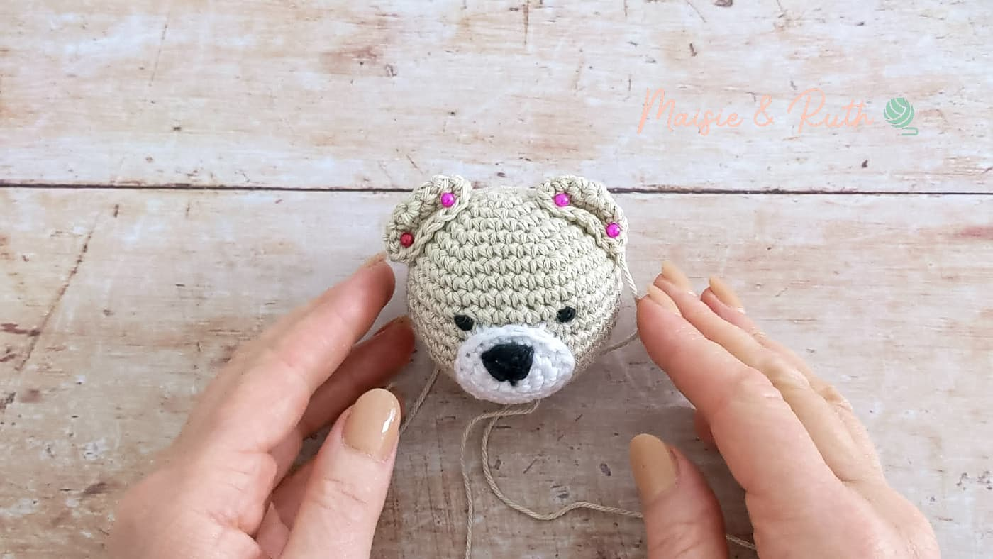 How to Crochet A Baby Rattle sew ears on