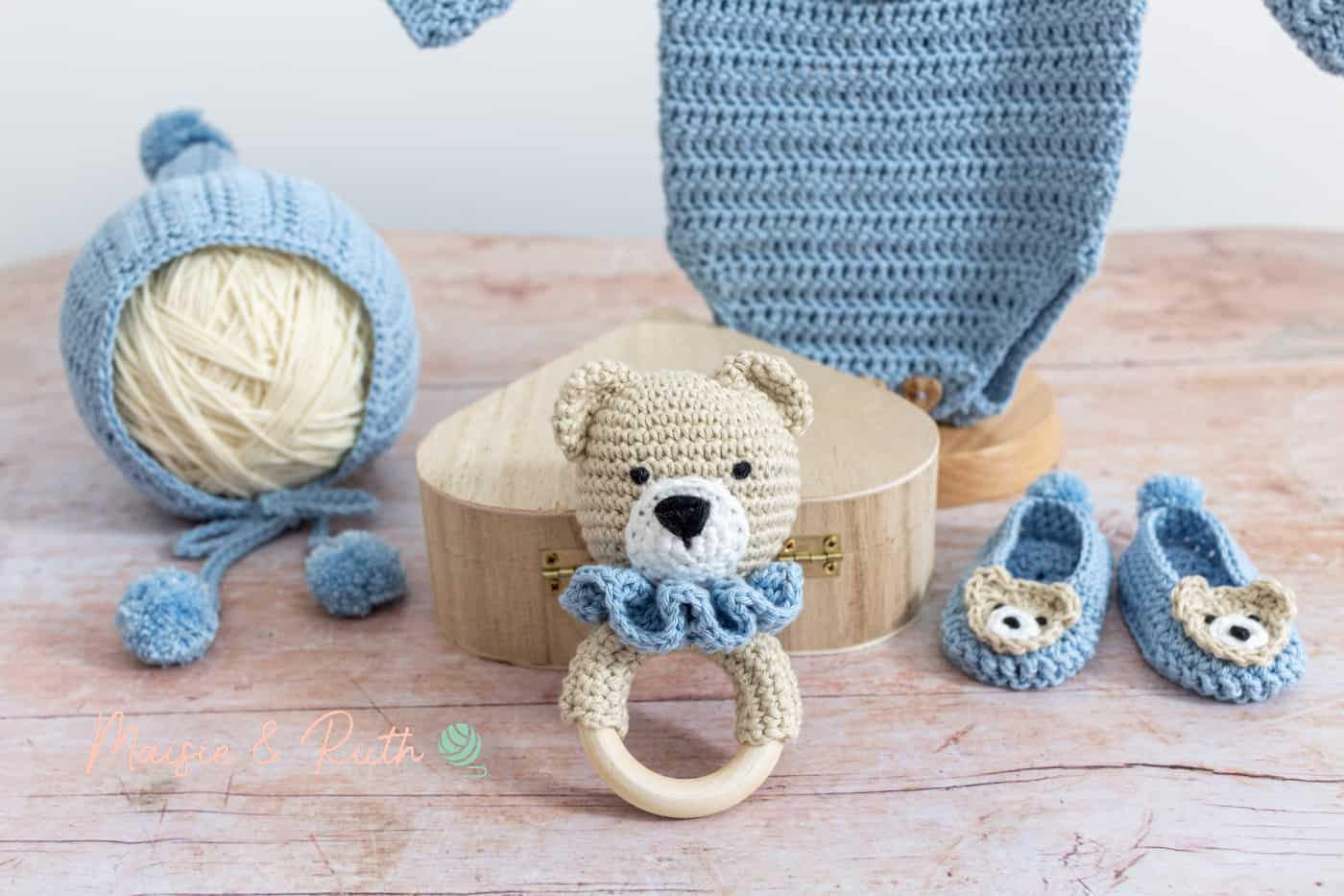 How to Crochet a Baby Rattle with blue layette