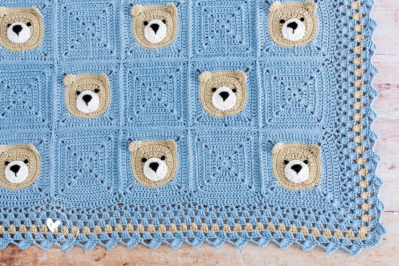 Bear Crochet Baby Blanket Flatlay on light wood table