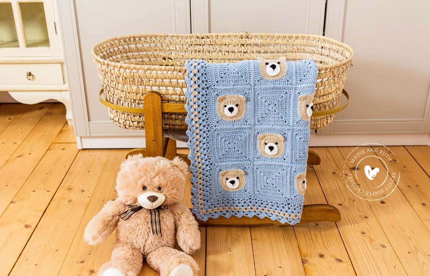 Bear Crochet Baby Blanket Teddy on floor beside bassinet