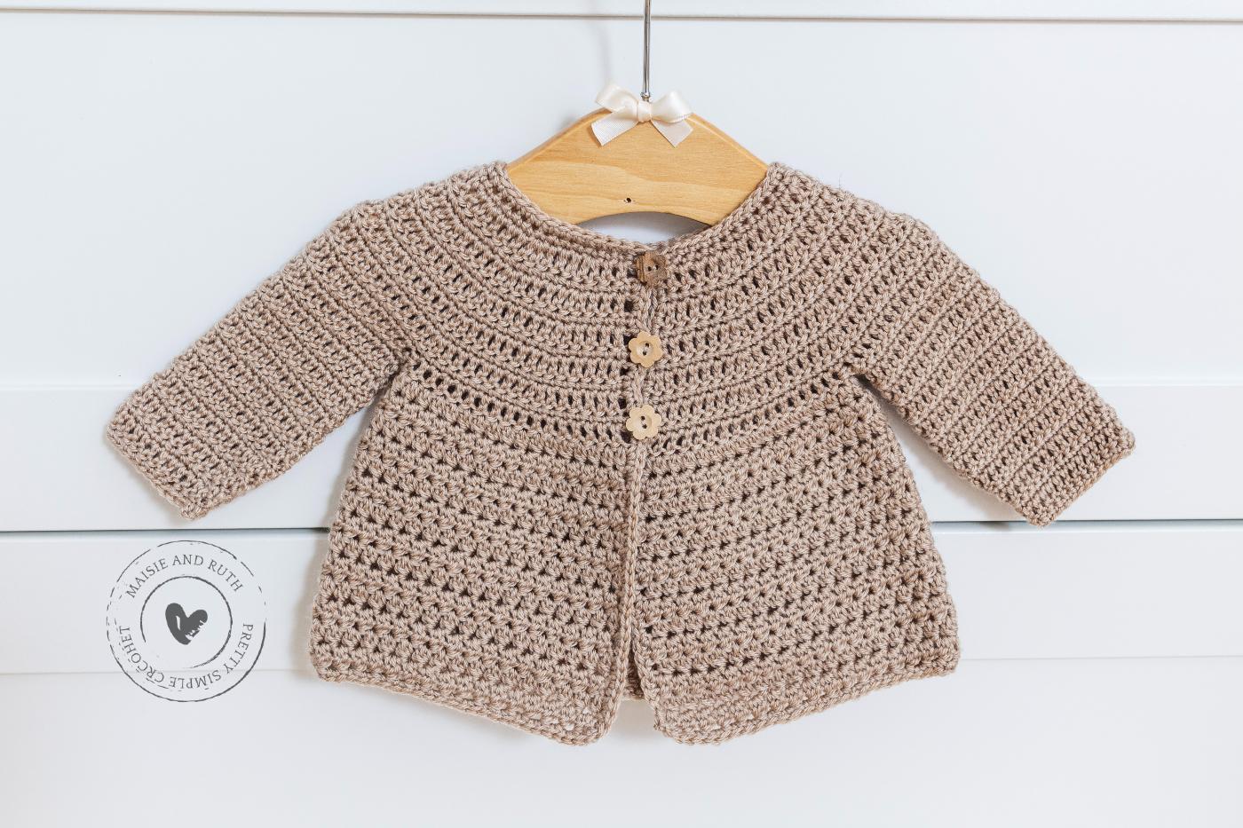 Crochet Baby Cardigan Pattern Hanging on drawers