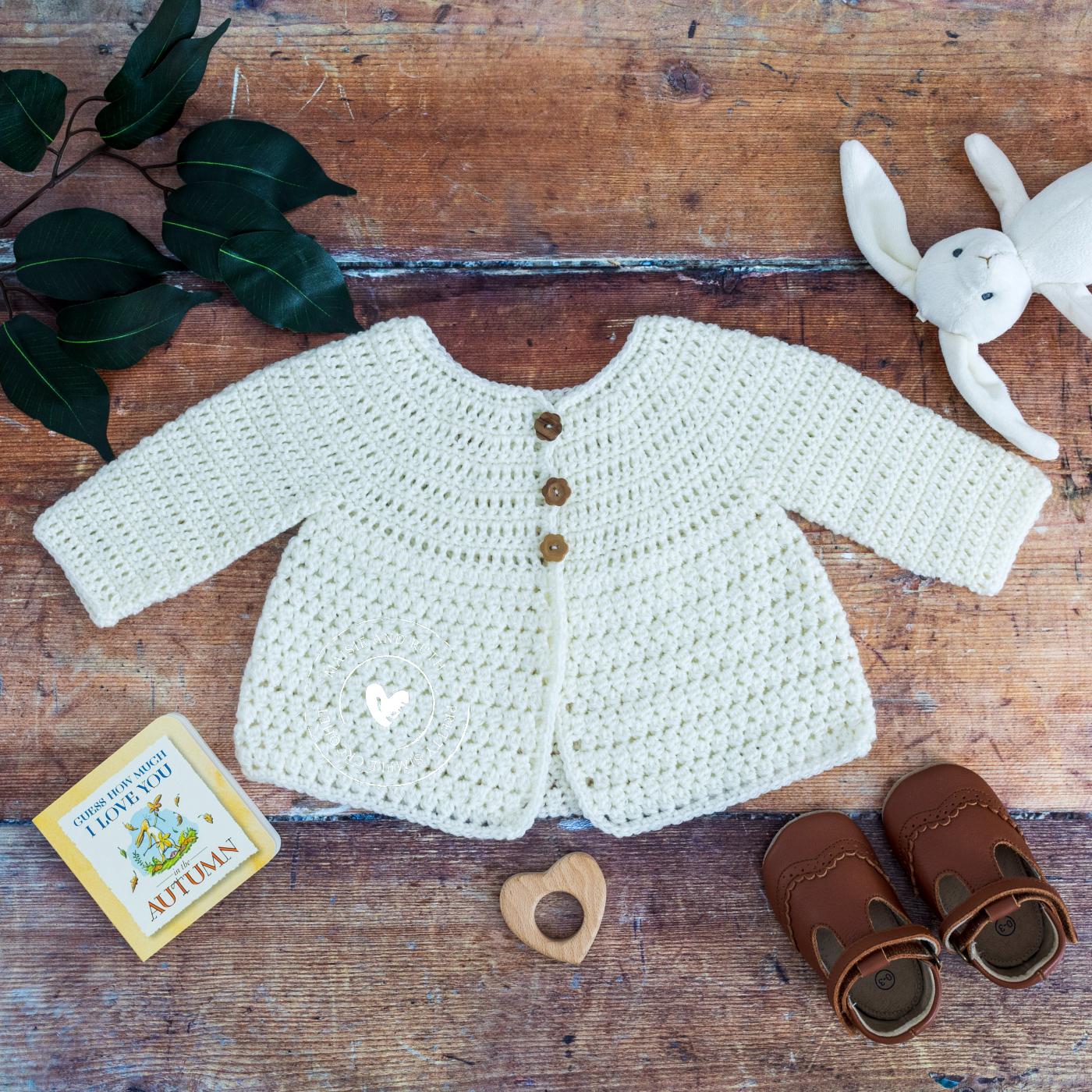Crochet Baby Cardigan Pattern Layette on wood top