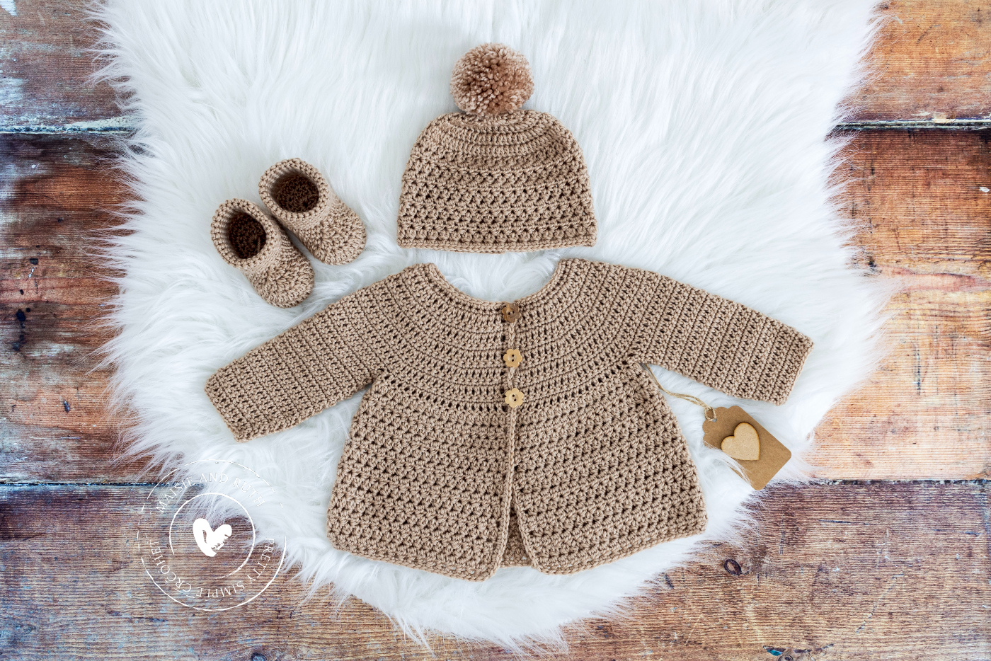 Crochet Baby Cardigan Pattern on white furry rug